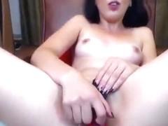 The black-haired girl Adelmyra hard fucks herself