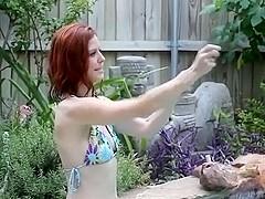Elle Renee blows to pop huge purple balloon