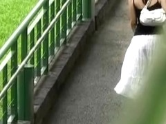 Asian babe in a long white skirt gets street sharked.