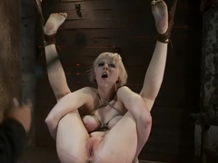 Blond with killer natural body, is suspended, suffers intense foot caningMade to cum over & over