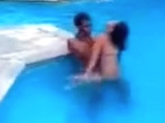 Latina girl couple fucks in the swimming pool and the shower