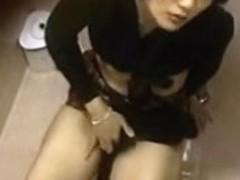 Asian girl masturbates on toilet
