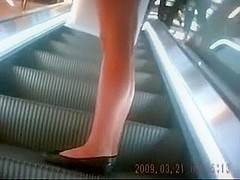 Following hawt and hot young chick in her sexy shorts filming her gazoo