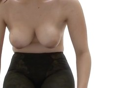 This Asian wench hides her big tits in her lingerie