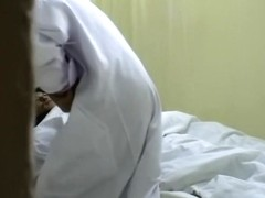 Cute nurse moans during hardcore Japanese fucking in bed
