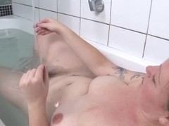 Busty curvy amateur touching her hairy cunt