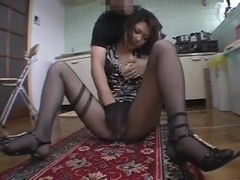 Beautiful Asian girl seduced in the kitchen