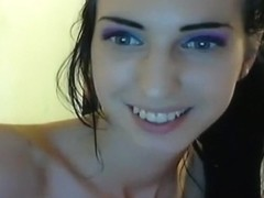 Hot dark haired girl shakes her booty closeup on cam and plays with her small tits