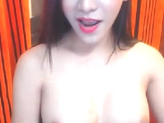 Asian shemale in a sexy show of ass and cock