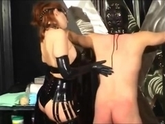Big booty redhead tortures her slave