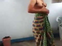 Indian wife with saggy tits puts on her clothes