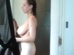 Busty chick masturbates in the shower