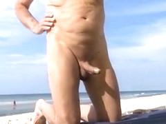 Older man jerks his dick on the beach