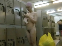 Filming her petite body in the locker room