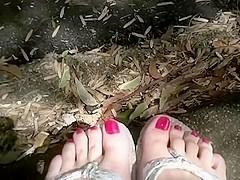 Worn out silver flip flops