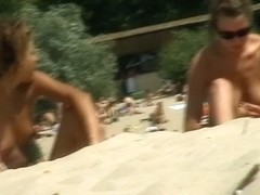 Beach voyeur gets his spy cam in action for a nudist shot