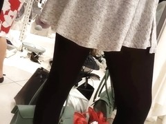 Sexy girl in super mini skirt and black tights