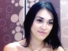 Beautiful brunette Adelyss fucks her ass