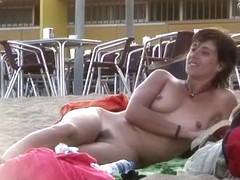 Attractive Italian woman sunbathes completely naked