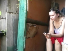 Amateur urinates in the outhouse as the watchman spies on her