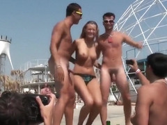 Topless babe dancing with naked guys in public