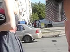 Skinny brunette on high heels in the upskirt video