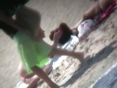 My girlfriends are playing on the beach while I film them