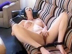 Cute gal masturbates on couch during the time that her boyfriend films her