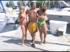 Older with two babes on a motorboat