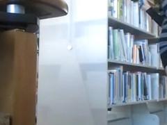 Female student makes upskirt selfie in library