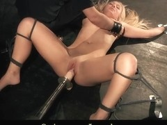 Bondaged blonde drilled by huge fuck machine