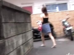Busty Japanese girl spied on while walking home