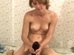 Tiny tramp fucking an enormous black dildo