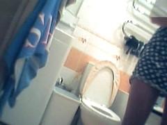 Girl in polka dot dress upskirt masturbation in toilet