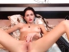 Amyjolie fucks herself on a wide bed