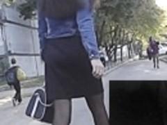Dark hose up her mini petticoat