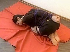 Fetish porn with tied brunette lying on the floor