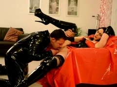 Whore in stockings receives cunnilingus in latex movie