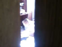 My spy cam peeks at the topless girl ironing her clothes