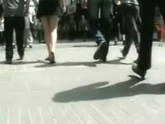 Upskirt porno video of a sexy brunette in a dark skirt and a big butt