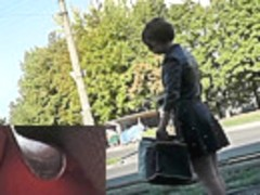 Upskirt free footage presents young girl in dark skirt