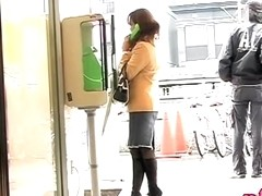 Pay phone sharking action with glamorous Japanese girl being really surprised