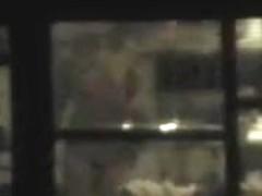 girl nude in living room voyeur through window