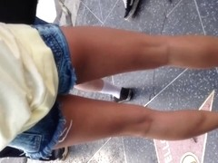 Sexy long white legs in daisy dukes
