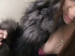 A downblouse view of an Asian girl