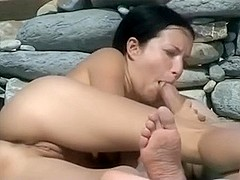 Gagging on a plump dong on the beach