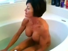 Short-haired busty darksome brown takes a washroom on cam