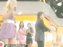 Blonde Latin bombshell makes upskirt magic on TV