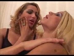 2 Cute Blonde trannys licking tenderly each other