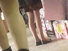 Sweetie in high heels in the escalator upskirt scene